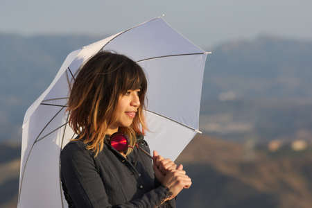 Young woman with white umbrella Stock Photo