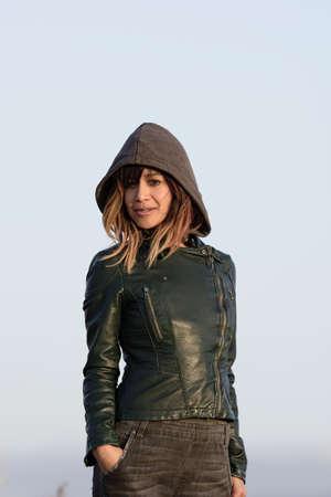 hooded sweatshirt: Young woman in hooded sweatshirt and green jacket Stock Photo