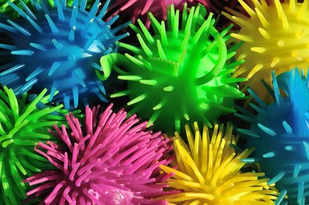Background of colorful soft spiny rubber fish toys photo