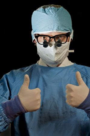 Surgeon gives thumbs-up for success Stock Photo - 5002343