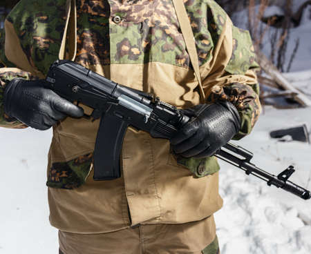 ak47: holding an AK-47 in the hands of the military