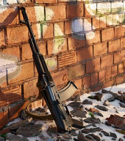 ak47: ak-47 on background wall, side view