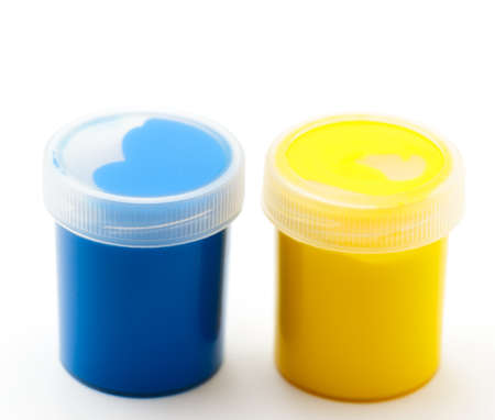 paints: yellow and blue gouache paints Stock Photo