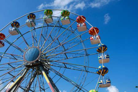 A colorful big fun wheel against blue sky Stock Photo - 5464069
