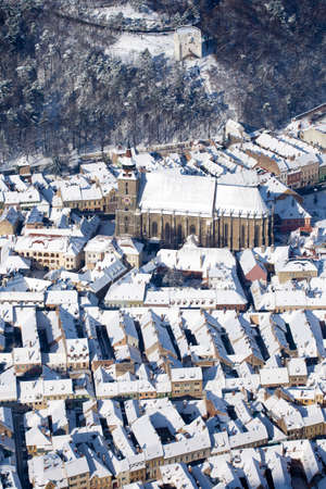 Aerial view of the gothic Black Church and defence White Tower, Brasov, Romania photo