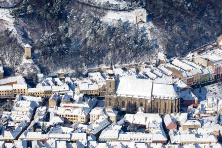 Aerial view of the gothic Black Church and defence White and Black Towers, Brasov, Romania photo