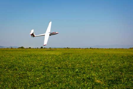 gliding: Glider flying on a blue sky Editorial