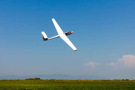 powerless: Glider flying on a blue sky Editorial