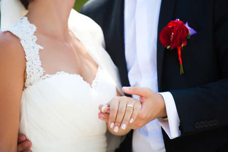 beautiful bride: Bride and groom holding hands and showing the engagement ring