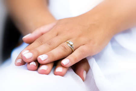 girl with rings: Wedding ring with stone on bride hand