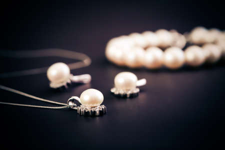 ear rings: Earings and necklace with pearls jewel