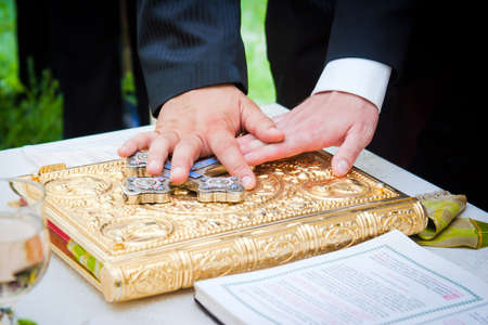 holy book: Hands on bible at a wedding ceremony