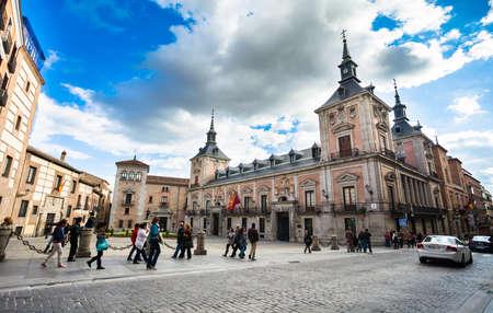 Madrid, Spain - May 6, 2012: Casa de la Villa in Villa Square (Plaza de la Villa) the City Hall of Madrid with tourist walking on a spring day, Spain