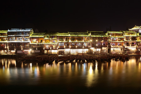 huang: Night by the river in Feng Huang. An old historic city in Hunan province. Stock Photo