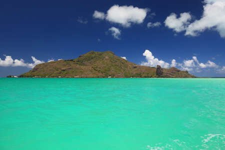 Dreamlike Colors of the Lagoon in Maupiti, French Polynesia. Full View of Maupiti Island in Background   photo