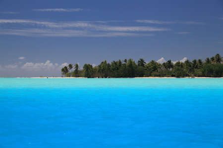 motu: Perfect Blue Colors of the Lagoon in Maupiti, French Polynesia. Motu in Background