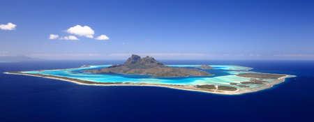 Full View of Bora Bora Lagoon, French Polynesia from above on a near cloudless day. Prime honeymoon destination