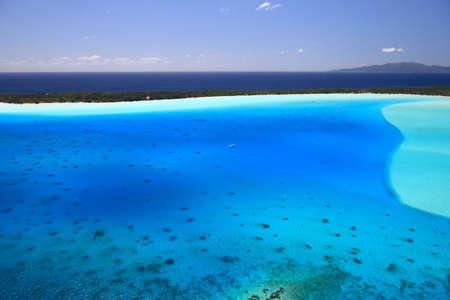 Bora Bora Lagoon, French Polynesia from above. Dreamlike colors. Tahaa in Background Archivio Fotografico