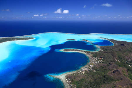 Bora Bora Lagoon, Motus and Main Island in French Polynesia from above. Dreamlike colors.   Stock Photo