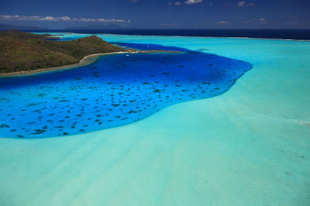 Bora Bora Lagoon, French Polynesia from above. Dreamlike colors.  photo
