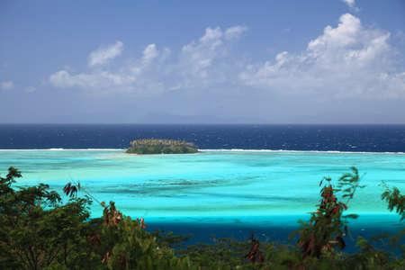 Raiatea Lagoon with small Motu in French Polynesia from above. Dreamlike colors.   Archivio Fotografico