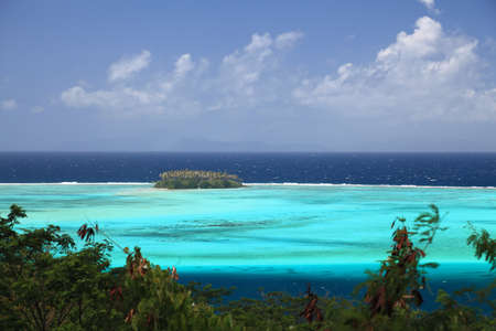 south pacific: Raiatea Lagoon with small Motu in French Polynesia from above. Dreamlike colors.   Stock Photo