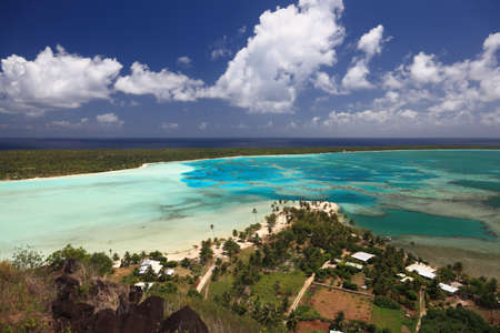 south pacific: Maupiti Lagoon, Motus and Main Island in French Polynesia from above. Dreamlike colors.   Stock Photo