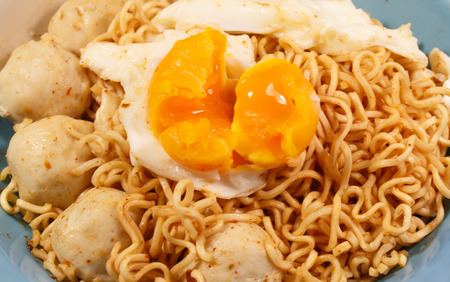 cooked instant noodle: Mama noodles, eggs, delicious meatballs.