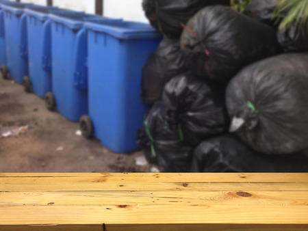 product placement: Wood table for product placement and blur the background for the trash heap.