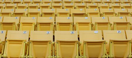 grandstand: Yellow seats on the grandstand.