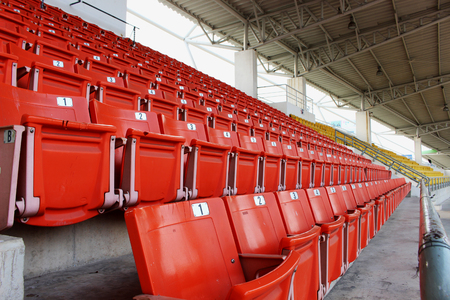 grandstand: Red seats on the grandstand in the stadium. Stock Photo