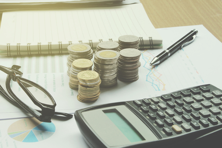 housing lot: Calculator and Coins of thailand on the office desk investment and property for concept. Stock Photo