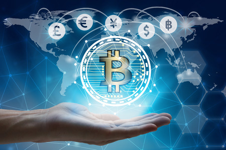 hand holding global network using Currencies sign symbol interface of Bitcoin Fintech, virtual currency blockchain technology concept, Investment Financial Technology Concept.