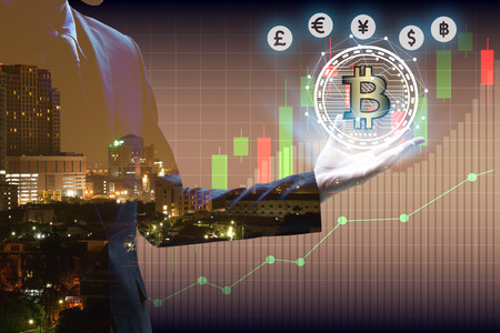 Double exposure of businessman Hand holding bitcoin and virtual currency with cityscape and stock market or financial graph for financial investment concept.