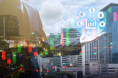 Double exposure of businessman holding virtual currency with cityscape and stock market or financial graph for financial investment concept. Banque d'images