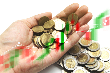Double exposure of Saving the Coins of thailand with stock market or financial graph for financial investment and trading concept. Stock Photo
