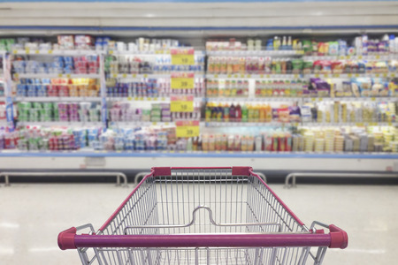 Supermarket aisle with empty shopping cart, Supermarket store abstract blurred background with shopping cart. Stock Photo - 93639840