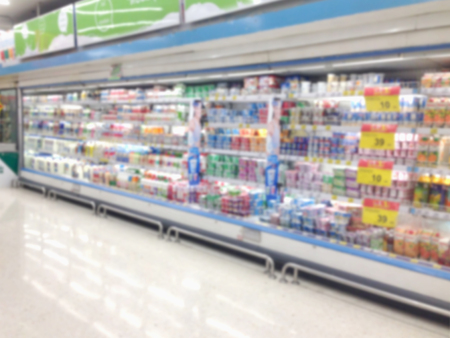 Abstract blurred supermarket aisle with shopping mall and retails store interior for background. Stock Photo