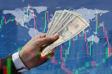 Double exposure of businessman Pay the US dollar with stock market or financial graph for financial investment concept.
