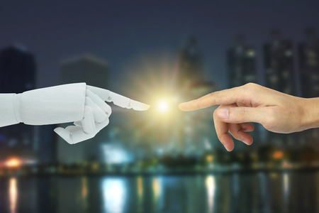 Robot and human hands touching on city background, Artificial Intelligence Technology Concept