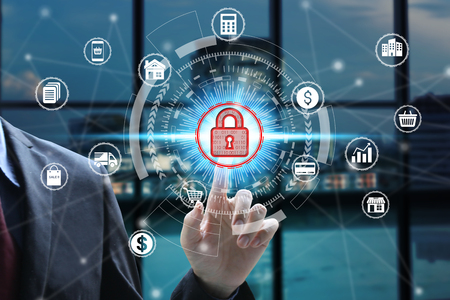Businessman touch virtual padlock icon over the Network connection, Cyber Security Data Protection Business Technology Privacy concept. Фото со стока