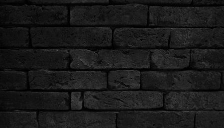 Black brick wall textured for background.