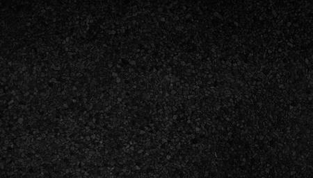 Black granite textured for background.