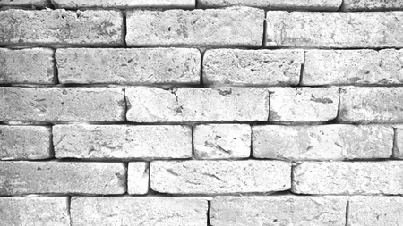 Gray brick wall textured for background. Фото со стока