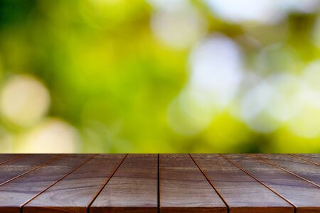 Wooden table on natural background for product display montage.