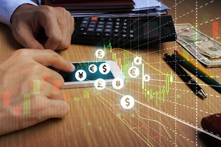 Businessman touch samrtphone network using currency icon technology with virtual screen icons, Investment Financial Technology.