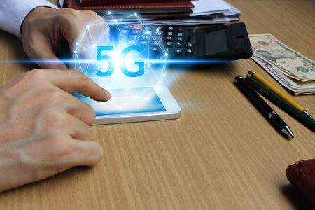 hand use smartphone network using 5G technology with virtual screen, Technology Internet 5G global network concept.