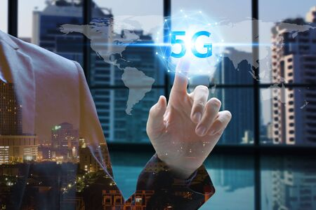 hand touch network using 5G technology with virtual screen icons on the city background, Technology Internet 5G global network concept.
