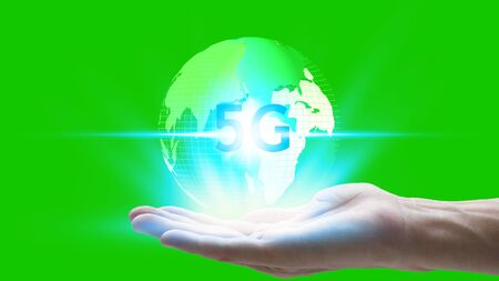 hand holding network using 5G technology with virtual screen icons on a green screen background, Technology Internet 5G global network concept. Standard-Bild