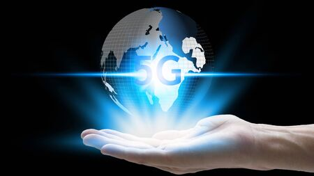 hand holding network using 5G technology with virtual screen icons on a black background, Technology Internet 5G global network concept.